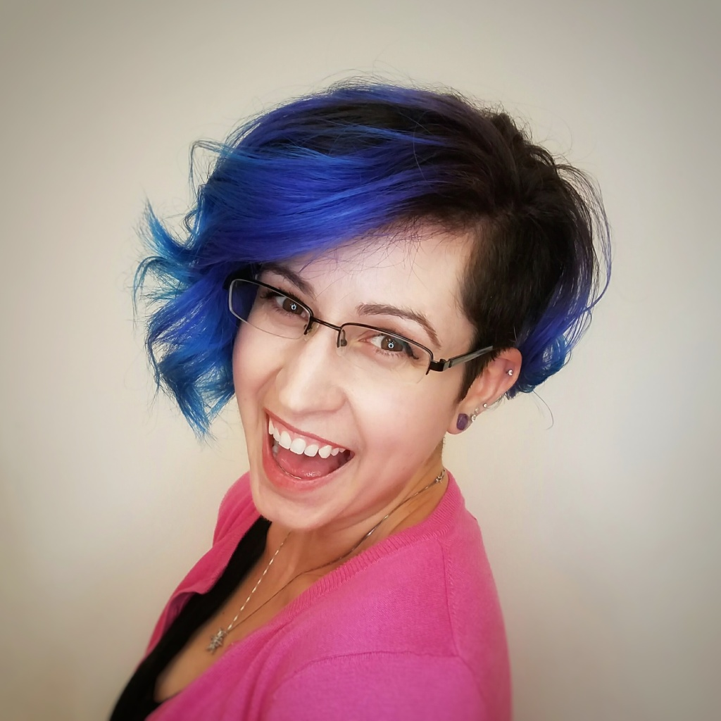 woman with blue hair laughing