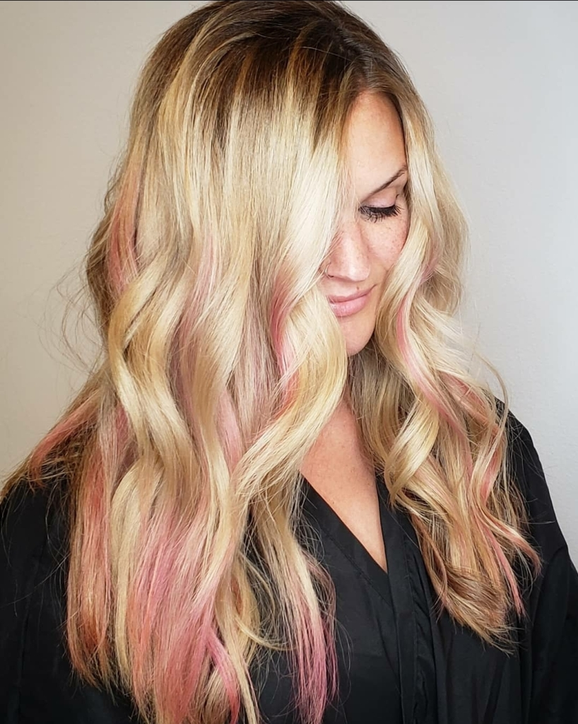 woman with blonde hair with pink streaks